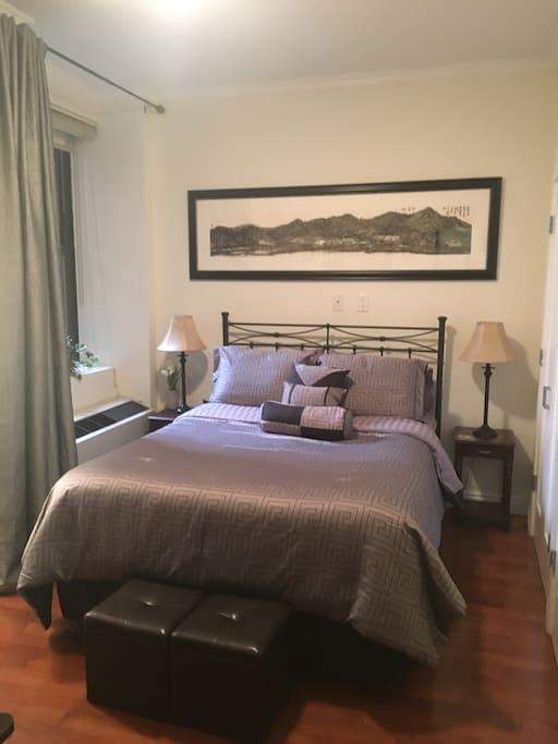 Designer Bedroom with Deluxe Queen Bed.