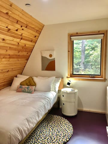 Downstairs bedroom located next to the bathroom. Queen size organic mattress and pillows.