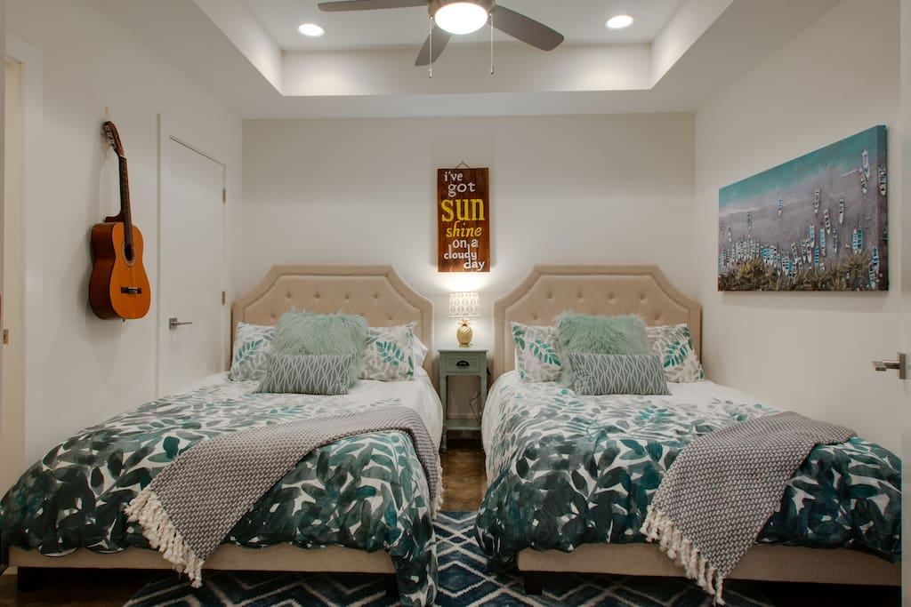 Welcome home! On the first floor, you'll find this precious, bright bedroom with 2 full beds and a half bath!