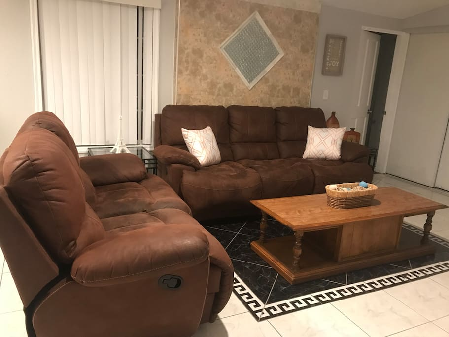Sofa in living room with recliner