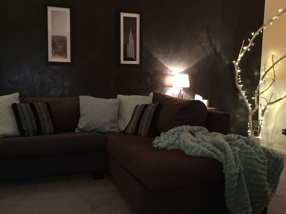 Cosy lounge with cool black plaster feature wall