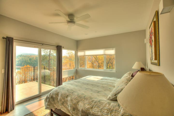 Upstairs master bedroom with private porch and lake view.