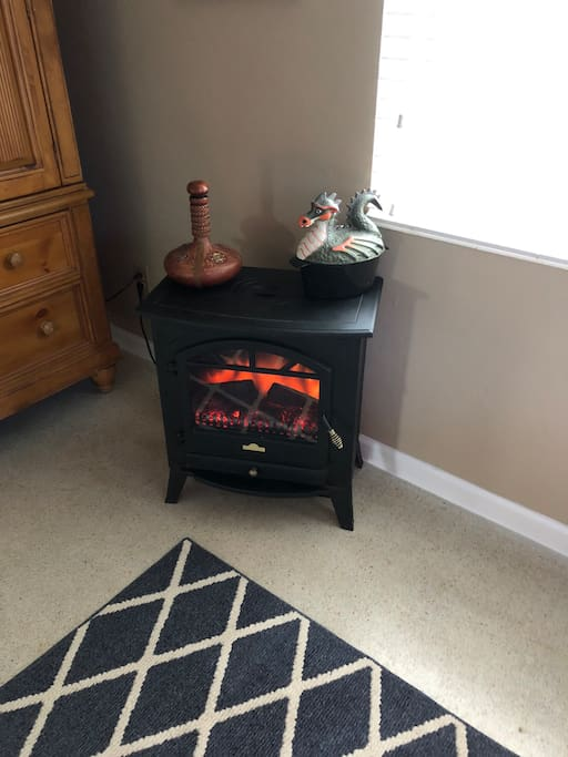 Electric Fireplace to warm you up or to set the mood...