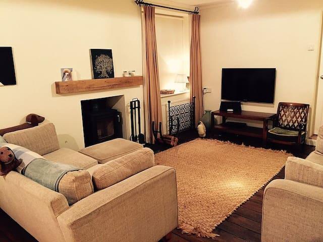 Lounge with woodburning stove.