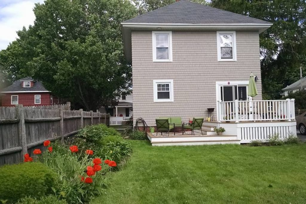 Amazing yard with perennial flower garden and a dual level deck for lounging and dining...take your pick.