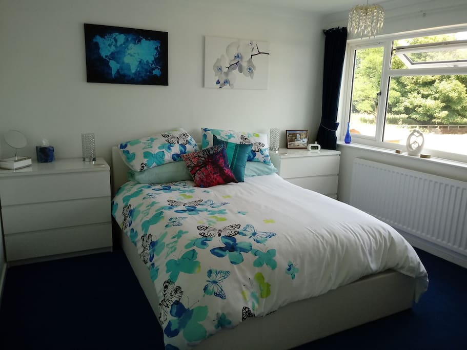double bedroom with rural views