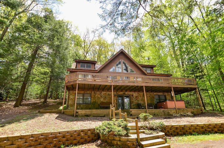 Dog friendly home with split lake front, dock slip, hot tub and fire pit!