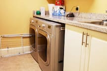 Laundry room with large capacity washer & dryer. Drying racks available for your delicate items. Please check for schedule prior to using.