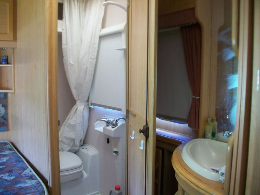 Shower, toilet and vanity unit