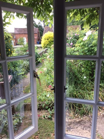 View from bedroom to canal barn and stables