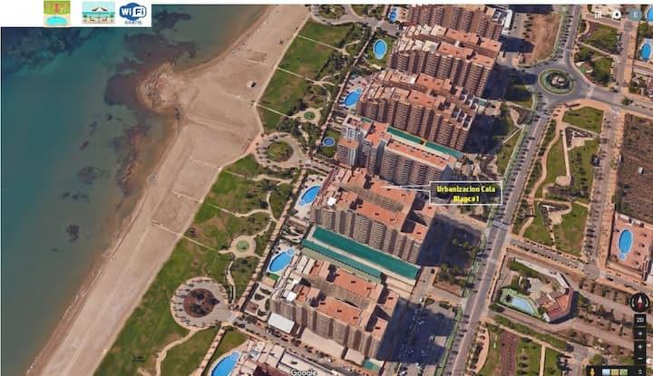 Apartamento 1ª Línea mar en Marina d'Or con césped