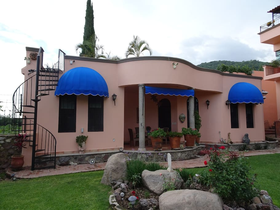 Front view of casita. Staircase to your own mirador with views of the mountains and lake.