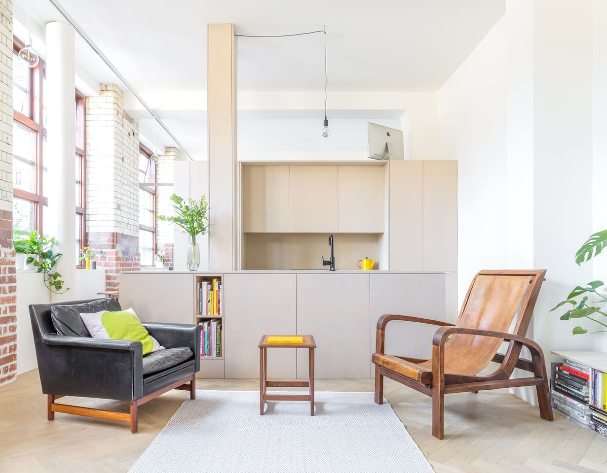 Beautiful, minimal and bright south facing living space with large factory windows and original glazed brick walls