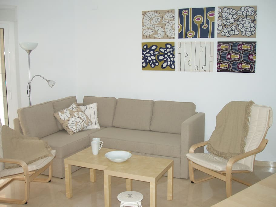Living-room with a double bed corner-sofa