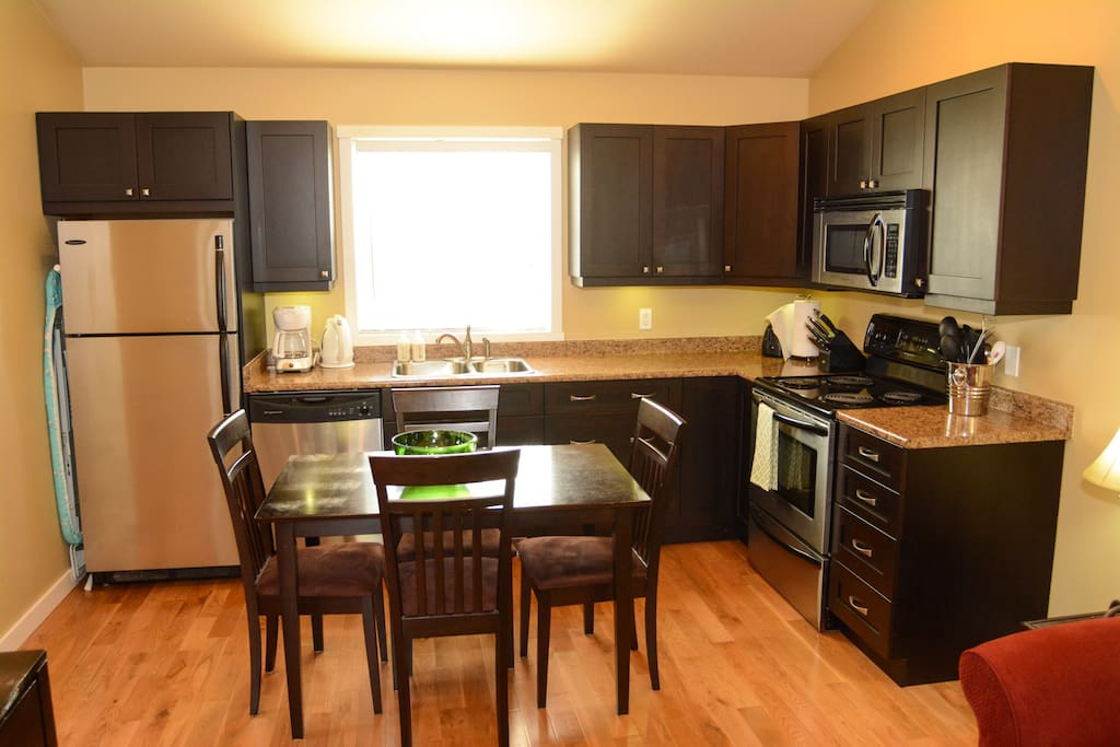 Full kitchen with fridge,dishwasher, microwave, and stove.