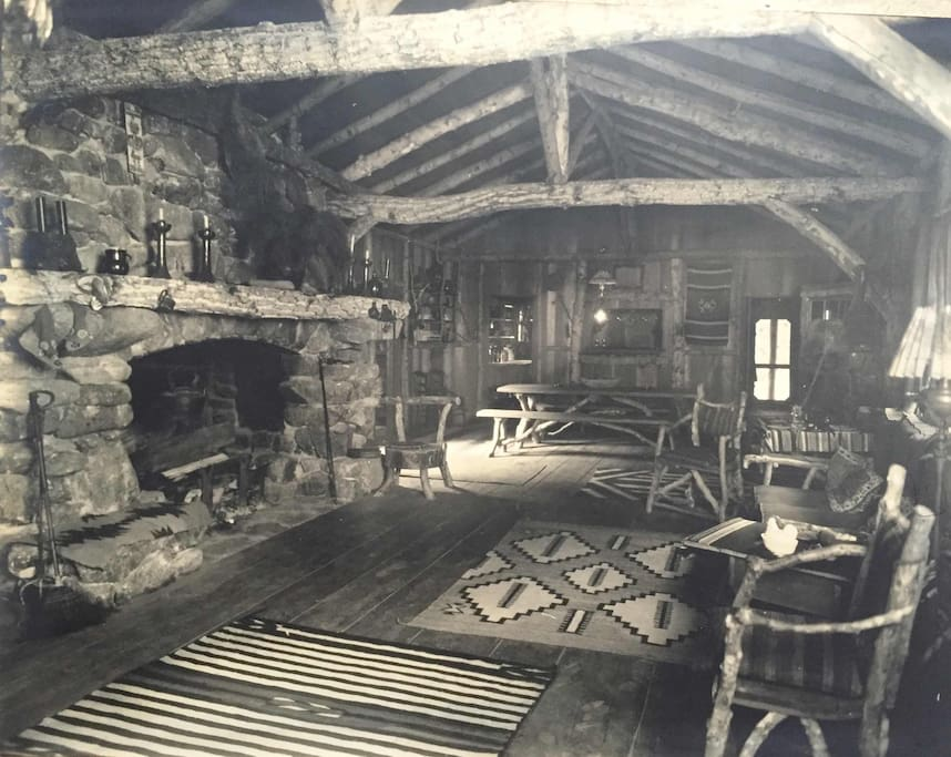 Another great photo of the great room from 1930's. Notice the wide plank clear heart redwood floors, stick furniture and wood accents are still beautifully in place today.