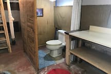 Basement features free laundry, and a rustic half bathroom.