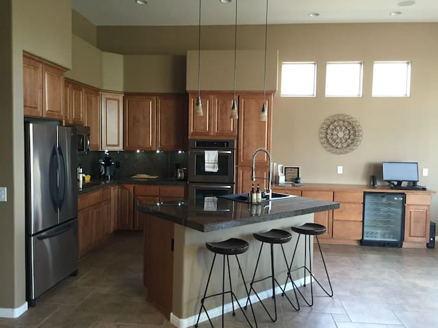 Open concept kitchen for entertaining, with double oven and large fridge.  Fully equipped and stocked!