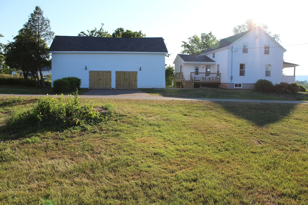 East side view of the house and property