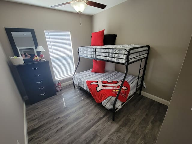Lets Go Cards!! Spacious bedroom two has a trundle bed for more sleeping space if needed.