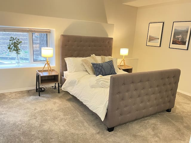 Queen bed with an upholstered head / foot board on the lower level. This room has a 2pc en-suite attached.