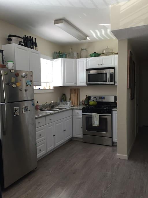 Gas stove, double-sided sink, full size fridge/freezer.