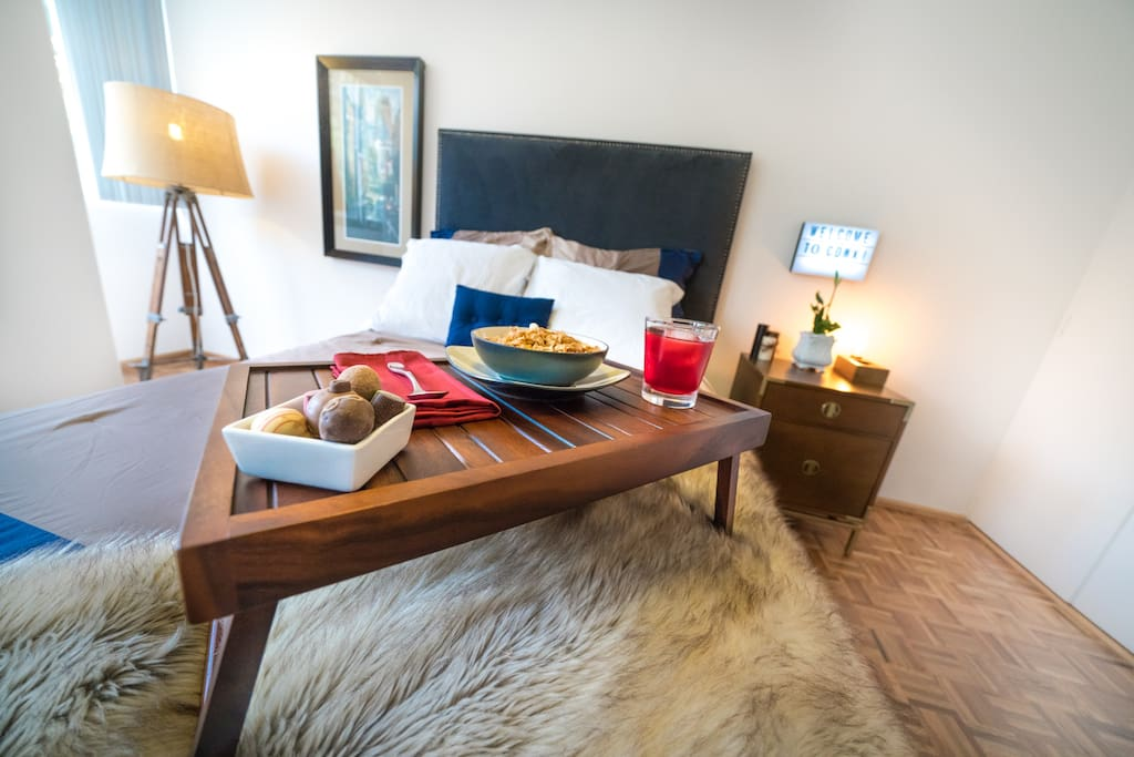 Come stay with us! Enjoy our comfy pillows, throw blanket (non-animal), and comforter.  Make yourself breakfast in bed in our ample kitchen and make use of our high-end bed-trays!