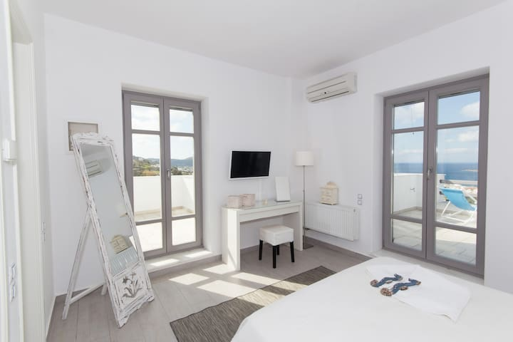The master bedroom in the upper floor with panoramic view