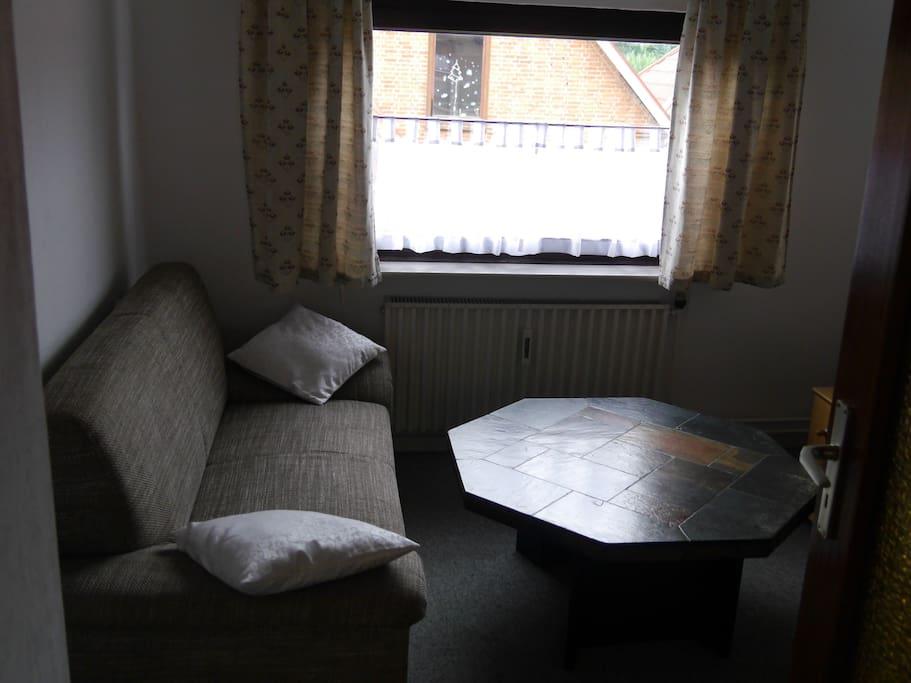 Wohnzimmer mit Fernsehschank
