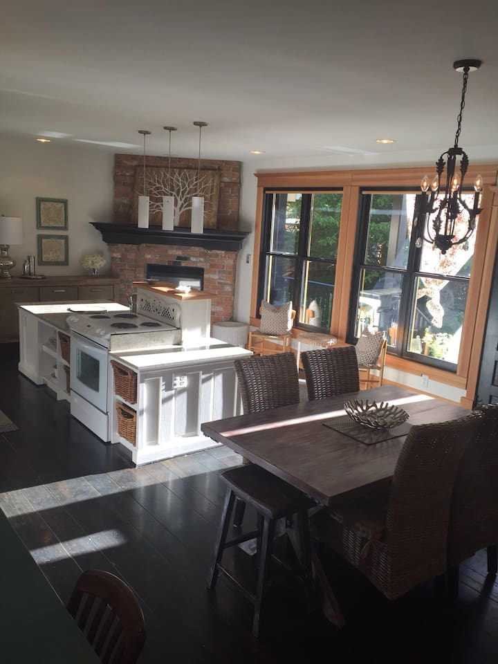 Amazing character kitchen with wrap around covered deck that has lighting and ceiling fans. Surrounded by gardens and trees. Facing BBQ patio.