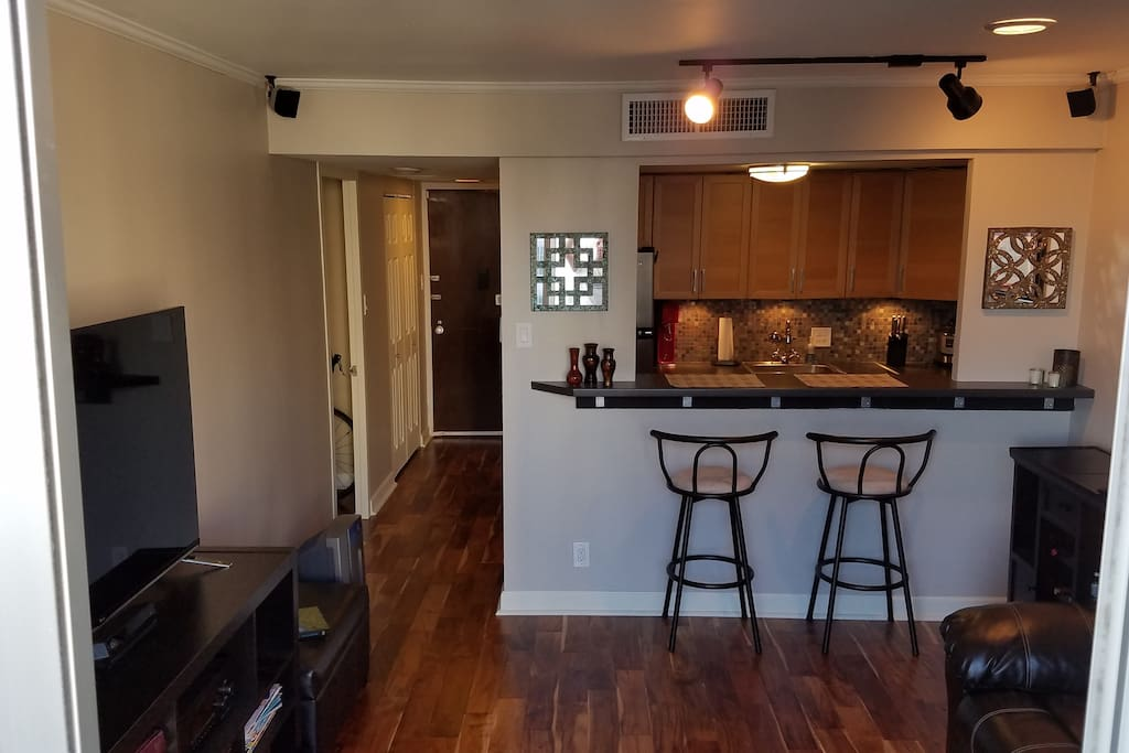 Barstool dining between kitchen and living room