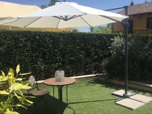 Delizioso appartamento con giardino