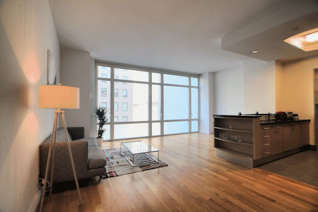 Other view of living room - you can see the 5th ave overlooking Empire State Building through the living room window