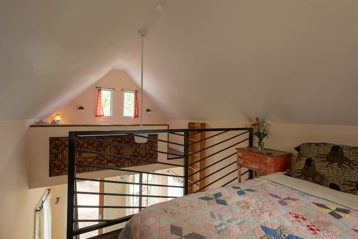 View of queen bed loft