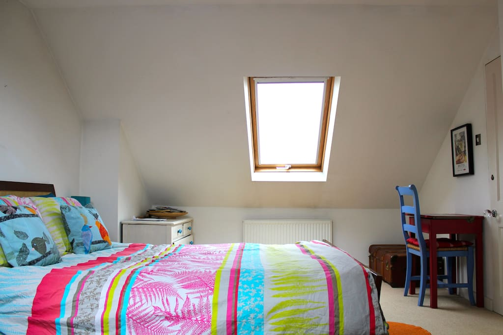 Your bright and sunny attic room with super comfy kingsize bed