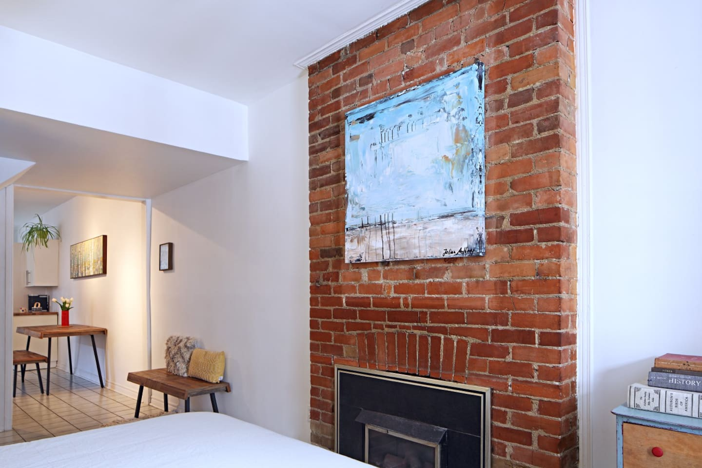Exposed brick and decorative fireplace in the bedroom