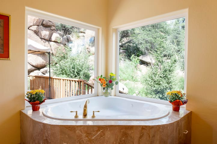 Oversized Jacuzzi in the Majestic Suite with stunning views (not seen here) when you peer up at the tips of the chubby cliffs while soaking inside the tub.