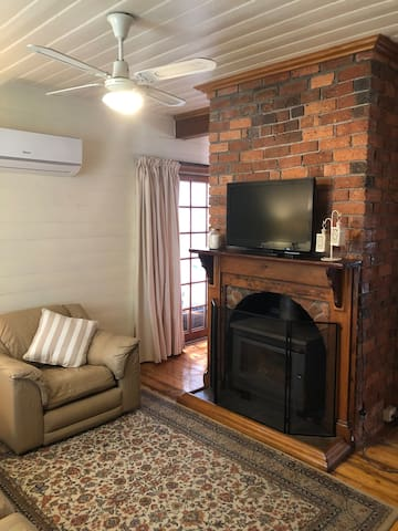 Reverse cycle heating and cooling in living area.  Alternatively, enjoy the warmth and ambience of the wood fired heater.  Wood, kindling and lighters are supplied.  Fire guard fitted for children's  safety
