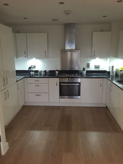 Kitchen with appliances and washer/dryer