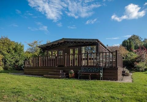 30, Caer Beris Lodge. A cosy, riverside haven.