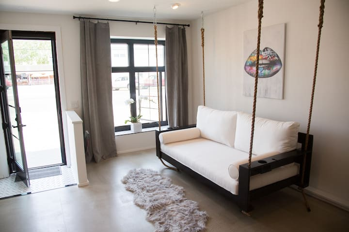 Entry room with custom built hanging, swing daybed.