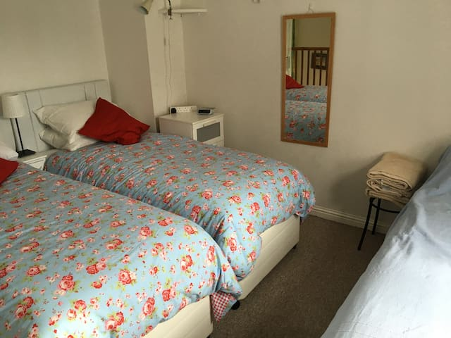 Triple bedroom (can be double + single) on request. Next to bathroom with bath/shower/basin/loo).