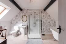 The Luxury Ensuite Bathroom with Rain Shower, Power Shower and Freestanding Tub Bath