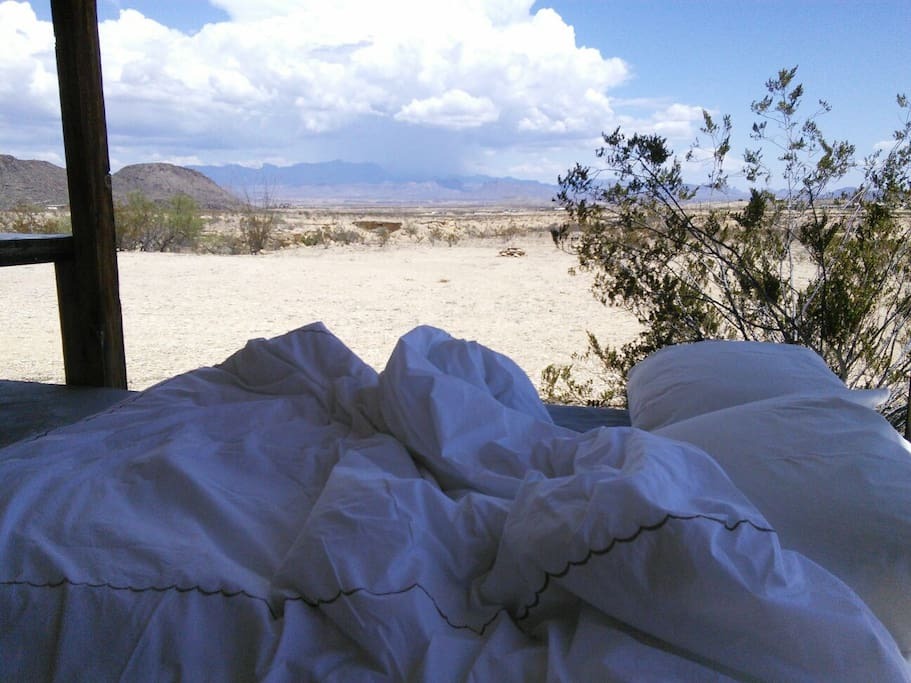 Sleeping inside or outside, there is always a beautiful view, to wake up to. Grab some pillows and a blanket from the linen closet and you're ready for an adult camping experience~ replete with pallet bed on rollers.