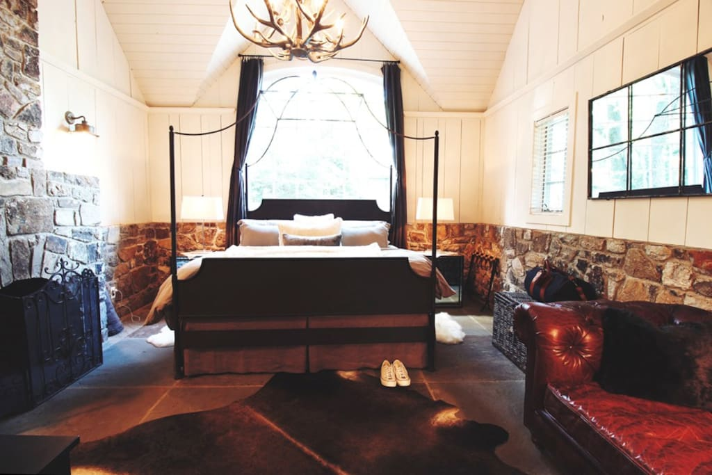 A king size bed and wood-burning fireplace