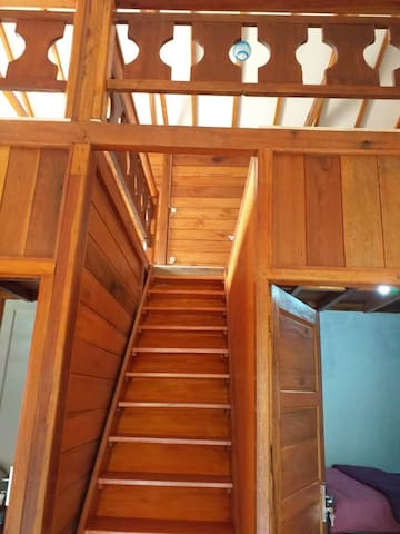 This is the wooden staircase leading to the loft where 4 guests can sleep comfortably.