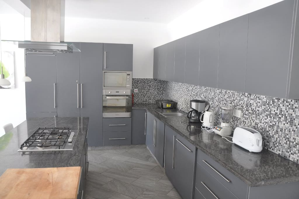 Kitchen with oven, microwave, gas cooker, dish washer, washing machine & dryer, etc.