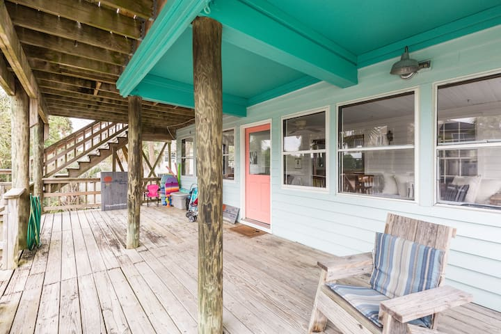 Beautiful covered deck is a great place to dry off or grab a drink to cool off after enjoying the sun & surf.  Air conditioned sun room awaits just inside...
