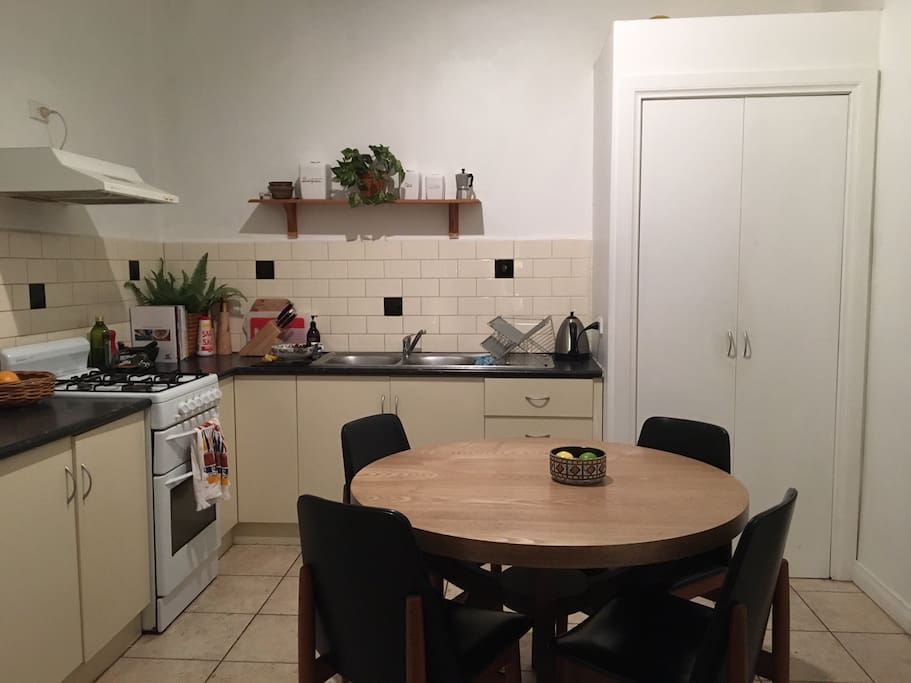 This is the kitchen, with a gas stove/oven. Dining table seats 4.
