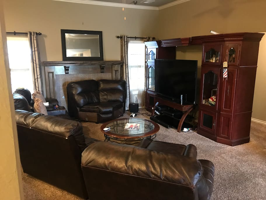 "Open Living Room Easily Seats (12) 73"" HDTV also available with DirectTV services."